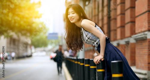 plakat Asian fashion girl on the street in Shanghai