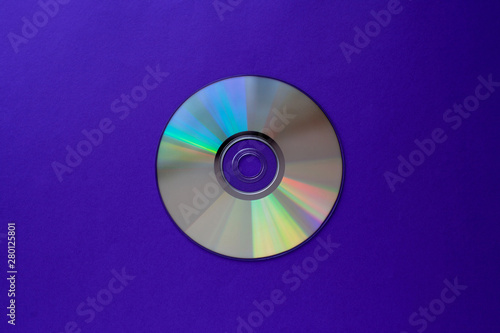 Obraz cd compact disc on  a dark blue background top view with copy space  - fototapety do salonu
