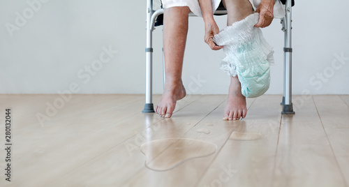 Urinary Incontinence in elderly and changing diaper Fototapet