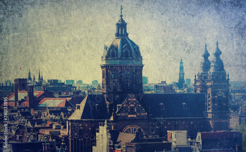 Photo  Amsterdam cityscape with old building of  Grand Amarath hotel