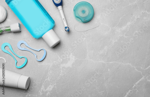 Fotografie, Obraz  Flat lay composition with tongue cleaners and teeth care products on grey background