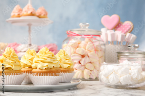 Candy bar with different sweets on white marble table Wallpaper Mural