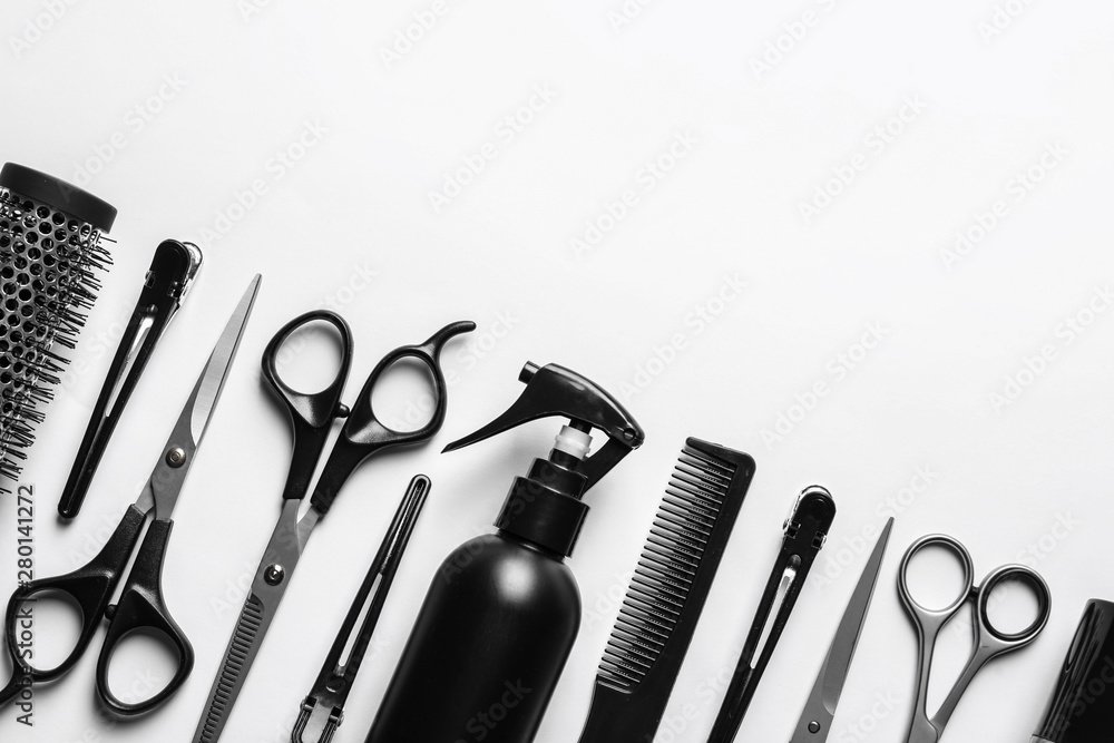 Fototapeta Composition with scissors and other hairdresser's accessories on white background, top view
