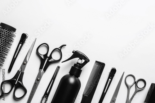 Fotografia  Composition with scissors and other hairdresser's accessories on white backgroun