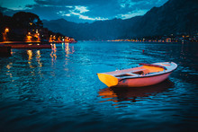 A Boat In Boka Kotorska Bay In The Evening. Beautiful Landscape With A Night Seaside And A Boat In The Water