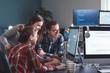 Leinwanddruck Bild - Team of programmers working in office