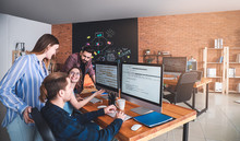 Team Of Programmers Working In...