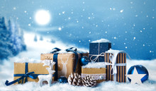 Christmas Gift Boxes In Snow On Winter Snow Landscape Background