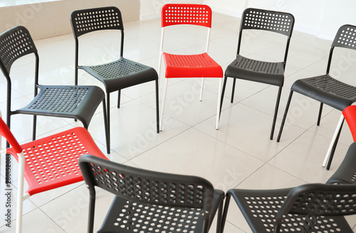 Photo  Empty chairs prepared for group therapy indoors