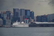 Classic Casino Cruiseship In Front Of Kai Tak Cruise Terminal And Kai Tak Kowloon Bay Skyline
