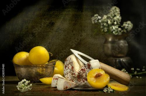 Fototapeta Yellow plums and cheese food still life obraz