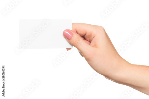 Obraz Empty sheet of paper in female hand with manicure isolated on white - fototapety do salonu