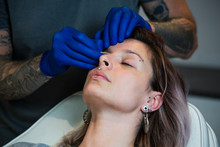 Man Showing A Process Of Piercing With Steril Medical Equipment And Latex Gloves. Marking The Piercing Spot. Body Piercing Procedure