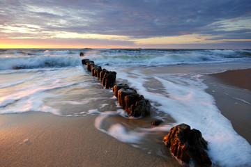 Fototapeta Morze Zachód słońca na wybrzeżu Morza Bałtyckiego,Kołobrzeg,Polska.