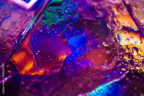 Background in the style of the 80-90s. Real texture of broken glass or ice and drops in bright acid colors. - 280200233