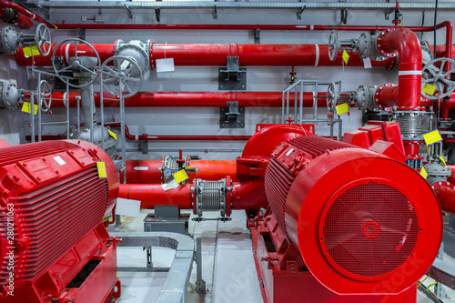 Poster Individuel Industrial fire pump station. Reliable and trouble-free equipment. Automatic fire extinguishing system control system. Powerful electric water pump, valves, and pipelines for water sprinkler.