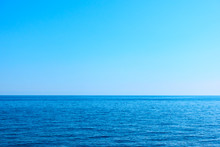 Seascape With Sea Horizon And Clear Blue Sky