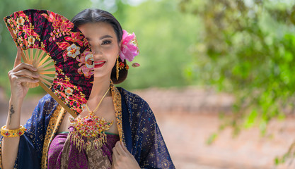 Beautiful women and old traditional dress Thai culture in Lanna style Chiang Mai province the north of Thailand