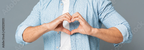 Carta da parati  Heart-Shaped Male Hands Gesture Closeup On Gray Background