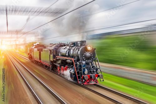 Vintage black steam locomotive train fast rush railway Wallpaper Mural