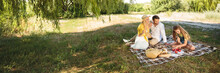 Family Picnicking Outdoors Wit...