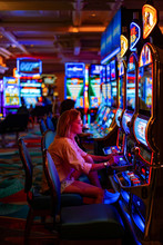Girl In A Casino In Las Vegas, .the Woman Plays For The Slot Machine