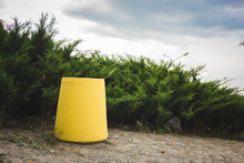 Yellow Trash Can Standing In T...