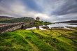Ancient Scottish castle and beautiful landscape of traditional nature.