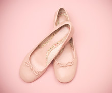 Pink Ballet Slippers On A Pink Background