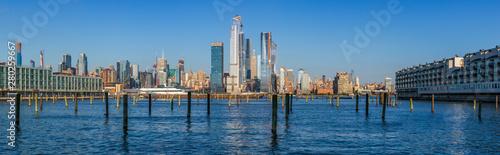 Cuadros en Lienzo View to Manhattan skyline from Weehawken Waterfront in  Hudson River at sunset