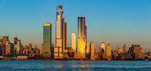 View To Manhattan Skyline From Weehawken Waterfront In  Hudson River At Sunset.