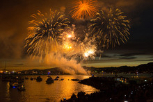 Panoramic View Of Fireworks Exploding Over Bay