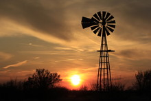 Kansas Windmill Silhouette At Sunset With Clouds