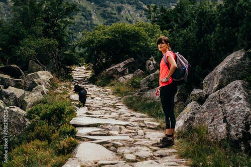 Fototapeta Young woman on the trail in Giant Mountains (Karkonosze), authentic travel experience.  obraz