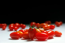 Small Tomatoes On A Two-tone Background.