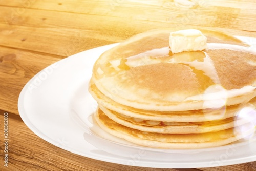 Stack of tasty pancakes with butter on a white plate Canvas Print