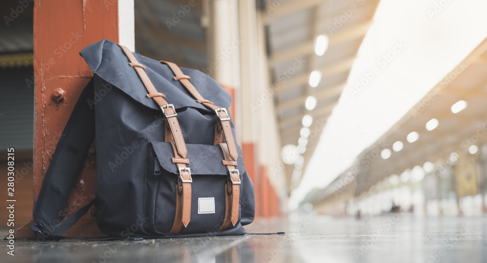 Fototapety, obrazy: Backpacks on the floor at train station and copy space