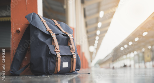 Obraz Backpacks on the floor at train station and copy space - fototapety do salonu