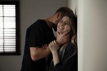 Man Choking Young Woman Indoor...