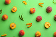 canvas print picture - Flat lay composition with fresh peaches on green background
