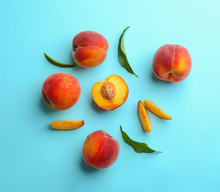 Flat Lay Composition With Fresh Peaches On Blue Background