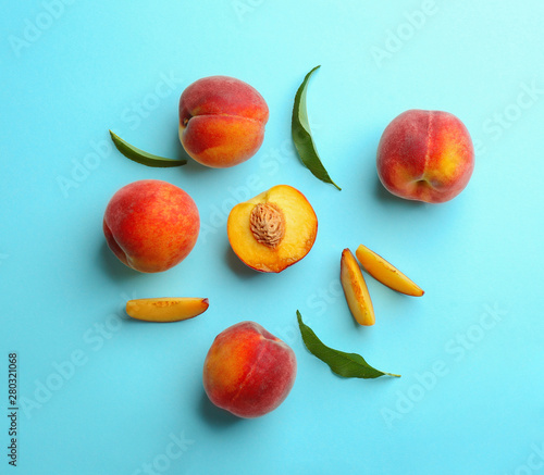 Flat lay composition with fresh peaches on blue background - 280321068