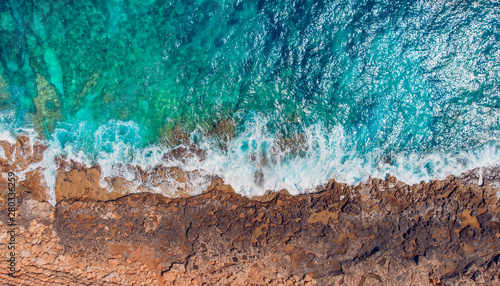 Tropical coral beach, azure water, turquoise sea. Aerial top view
