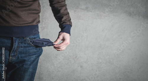 Man showing empty pocket. Bankruptcy. No money - 280338802