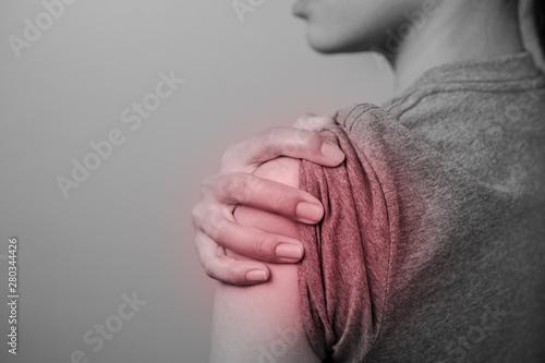 Vászonkép Woman with shoulder pain.