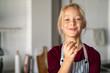 Leinwandbild Motiv Funny girl in apron eating handmade cookie
