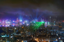 Symphony Of Lights Show In Hong Kong Downtown, Republic Of China. Financial District And Business Centers In Technology Smart City In Asia. Skyscraper And High-rise Buildings At Night.