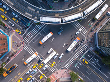 Aerial View Of Cars And Trains With Intersection Or Junction With Traffic, Taipei Downtown, Taiwan. Financial District And Business Area In Transportation Smart Urban City Technology Concept.