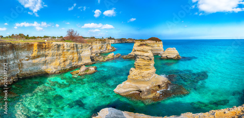 Picturesque seascape with cliffs, rocky arch at Torre Sant Andrea