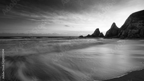 Foto auf Leinwand Grau Stunning black adn white sunset landscape image of Westcombe Beach in Devon England